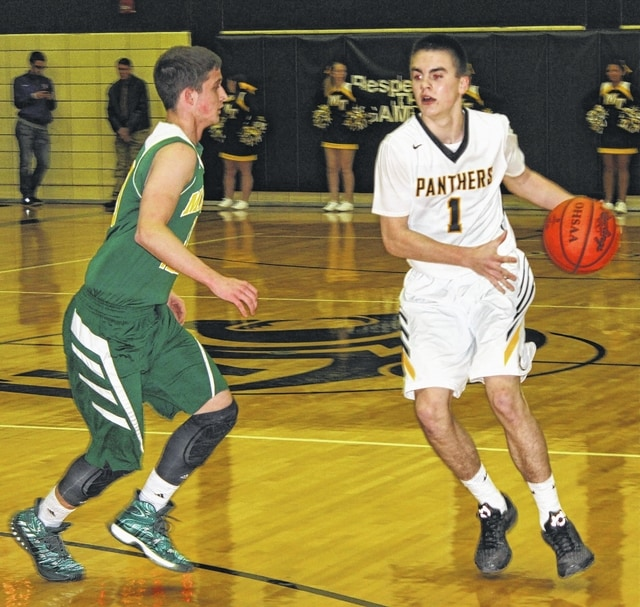 Miami Trace junior Cameron Carter (right) has the ball out on the perimeter during the McDonald's Holiday Tournament championship game against Madison Plains Friday, Dec. 30, 2016. Carter, who scored 22 points against Greeneview Wednesday and 20 against Madison Plains, was named the tournament's MVP.