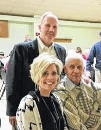 Paul LaRue (standing), Karla Morrison and Buck Harris were the speakers at the annual Fayette County Honor Guard Christmas Dinner.