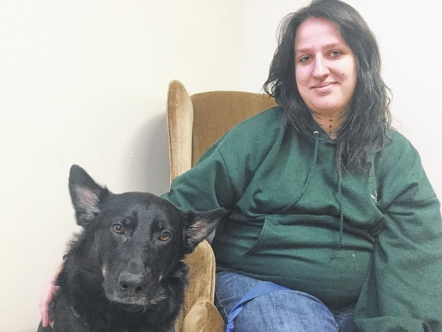 Anna Thornhill and her service dog, Thor.