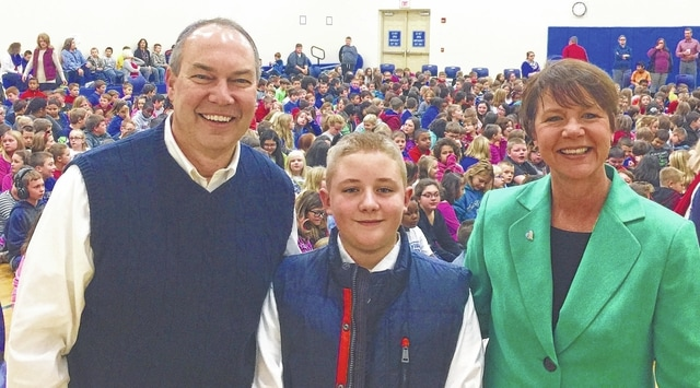 State Sen. Bob Peterson, Garrett Wahl (student), and Supreme Court Justice Sharon Kennedy pose for a photo after an assembly at Belle Aire Intermediate School Monday. The senator and justice spoke to the kids about their jobs and how it plays into the government of the state.