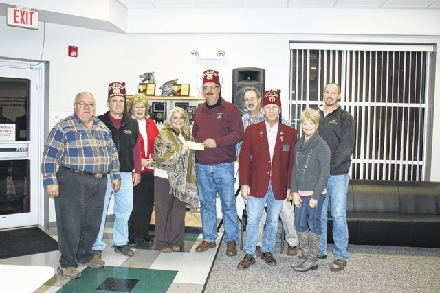 From left to right, Larry Mayer, president of Fayette County Board; PR Marshall, golf chairman; Caryl Bookman, board member; Deb Buccilla, superintendent at Fayette County Board of DD; Brian Tabit, president of the Washington Shrine Club; Mark Heiny, board member; Milan Hanson, 3rd vice president; Suzi McCracken, board member; and Cody Kirkpatrick, board member.