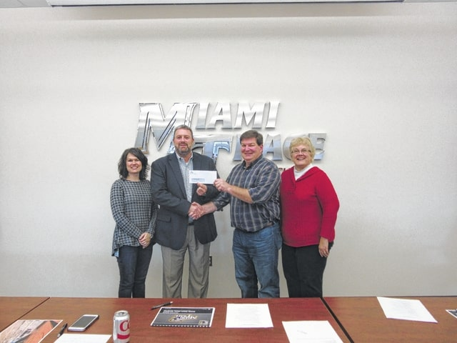 Valero Energy Foundation recently donated $10,000 to the Miami Trace Local School District for SMART Interactive Panels. In the photo are Kate Dolphin of Valero, Miami Trace Superintendent David Lewis, Karl Charron of Valero, and Katy Zink of Miami Trace.