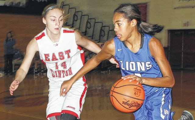 Washington freshman Rayana Burns drives against East Clinton's McKenzie Campbell during an SCOL game at East Clinton High School Wednesday, Dec. 7, 2016.