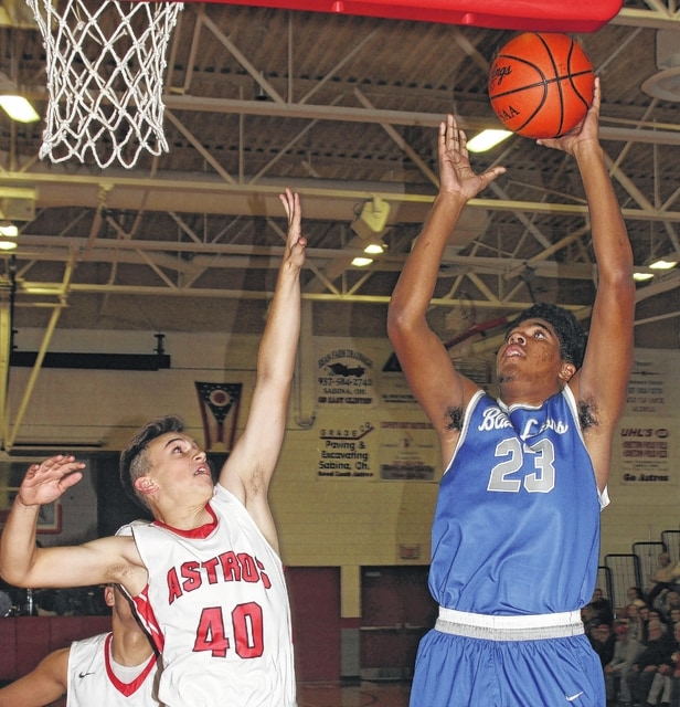 Washington sophomore Richard Burns Jr., right, puts up a shot for two of his 10 points during an SCOL game at East Clinton High School Friday, Dec. 9, 2016. On defense for East Clinton is freshman Matt Mitchell.