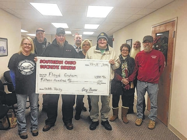 The Southern Ohio Buckeye Bikers have been donating to veterans recently within the county. Floyd Graham was one of the recent recipients and received $1,500. Pictured is Graham and various members of the Southern Ohio Buckeye Bikers.