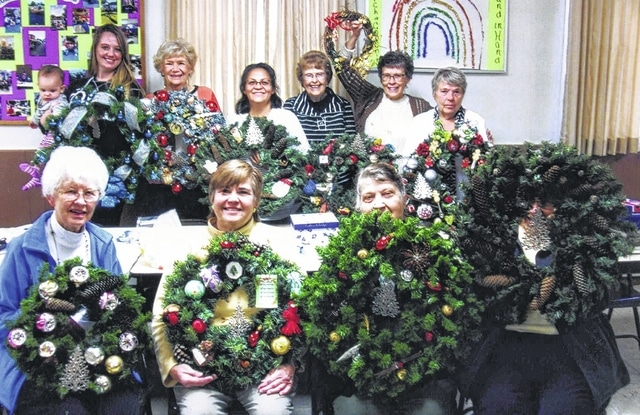 Members of the Fayette Garden Club recycled old wreaths during a recent meeting.