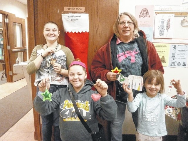 Tonya Reigelsperger, Wendy Decker, Layia Card and Gabriella Webb enjoyed crafting Christmas ornaments with Miss Linda at Jeffersonville Branch Library recently.