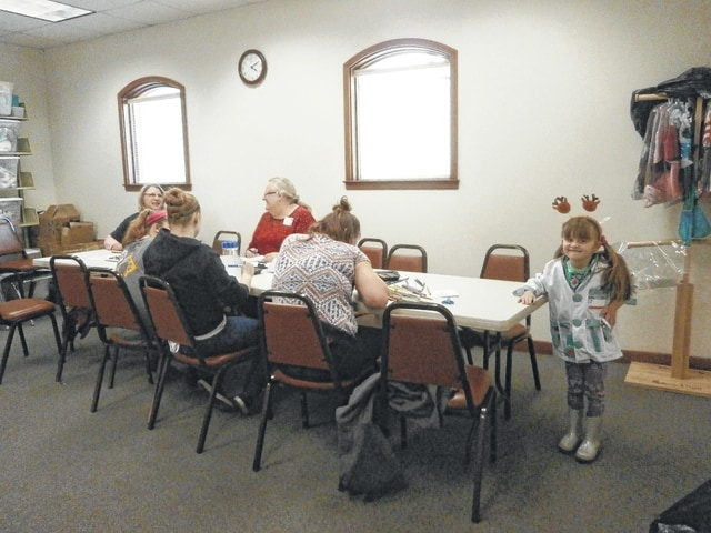 "Jeffersonville Branch Library was the place to be for Miss Linda's Kiwi CD Calendar craft as well as playing dress up with Miss Gabriella (end of table), posed as a doctor for the camera. The library would also like to mention that, sadly, this was Miss Linda's last craft session as she is retiring after 10 ""spectacular"" years of service at the library."