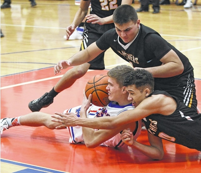 Seth Leach, above, and DeAndre Pettiford, at right, vie with a Clinton-Massie player for the ball during the SCOL-opener for both teams Tuesday, Dec. 6, 2016 at Clinton-Massie High School.