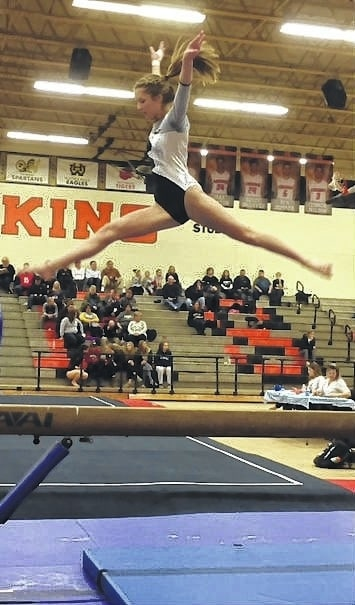 Miami Trace freshman Abby Arledge, leaps high over the top of the four-inch wide balance beam at a meet at Anderson High School Saturday, Jan. 14, 2017.
