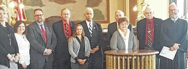 On Dec. 12, Fayette County Veterans Service Commissioner Robert L. Malone was re-appointment for another five-year term by Judge Steven Beathard. Robert Malone currently serves as the representative for Disable American Veterans (DAV). Pictured from back row left to right is Karla Morrison, Secretary/Investigator of the Veterans Service Office; Amy Jackson, Service Officer of the Veterans Service Office; Eddie Wynne, Vice President of the Veterans Service Commission Board and represents Veterans of Foreign Wars; John Mason, President of the Veterans Service Commission Board and represents Amvets; Charles T. Harris, a member at Large; Edward Fisher, Secretary of the Veterans Service Commission Board and represents the American Legion; Robert L. Malone, represents Disabled American Veterans, Front row left to right is Tasha Harris, Receptionist of the Veterans Service Office; Judy Malone, wife of Robert Malone and the Honorable Steven P Beathard, Judge - Court of Common Pleas.