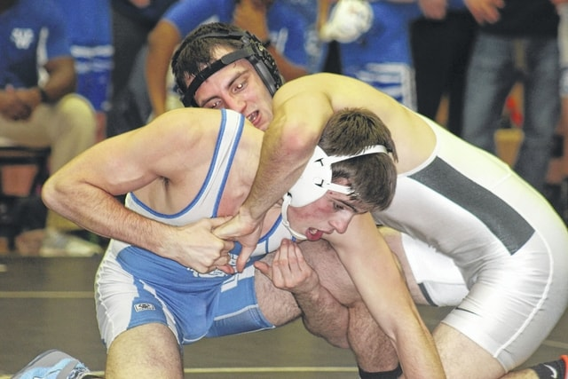 Miami Trace's Dereck Moore (facing left) wrestles Washington's Chris Conger at 152 pounds at the annual dual meet Thursday, Jan. 12, 2017 at Miami Trace High School. Moore won this match by pin.