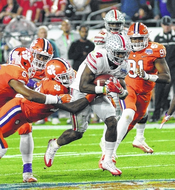 Ohio State's Curtis Samuel rushes up the middle for a few of his 67 yards against Clemson.