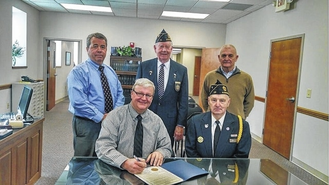 "The Fayette County Commissioners signed a proclamation Tuesday commemorating ""Four Chaplains Sunday."" Seated are Fayette County Commissioner Chairman Dan Dean and American Legion Post 25 Commander David Frederick. Standing from left to right are Commissioner Tony Anderson, Four Chaplains Program Chair Edward Helt, and Commissioner Vice Chair Jack DeWeese."