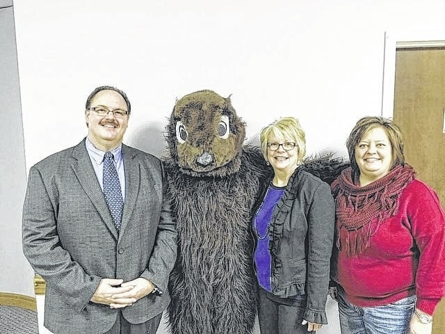 Groundhog Breakfast corporation sponsor, Nick Epifano of McDonald's of Fayette County, poses with the mystery groundhog, Chamber board chair Merleen Van Dyke and Chamber president Whitney Gentry.
