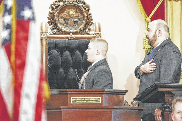 Belle Aire Intermediate fifth grader Garrett Wahl (left) led the Pledge of Allegiance during this week's Ohio House Session. Speaker of the Ohio House Cliff Rosenberger (right) was sworn in to his final term in the Ohio House of Representatives.