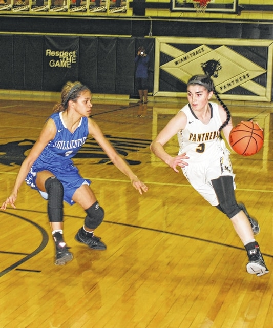 Miami Trace senior Hanna Reisinger (right) drives on Chillicothe freshman McKenzie Green during an SCOL game at Miami Trace High School Wednesday, Jan. 25, 2017.