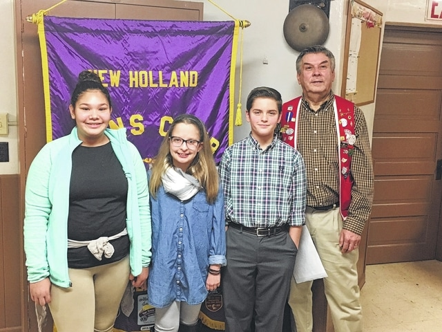 Pictured are the Peace Poster winners: (L-R) Aeriauna Urbina, Jordann Cockerill, Jacob Pettit, and New Holland Lions Club President Marty Mace.