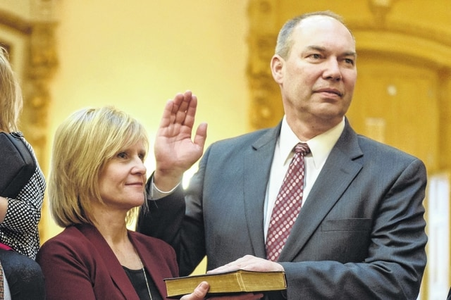 Senator Bob Peterson pictured with his wife, Lisa, while being sworn in as President Pro Tempore of the Ohio Senate.