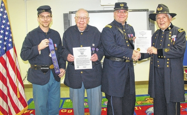 Members of Company C, 20th Ohio Volunteer Infantry Sons of Veterans Reserve (SVR), which is the military component of the Sons of Union Veterans of the Civil War, receive an award for being one of the most outstanding units in the country. Pictured (left to right): Shawn Cox, Richard Troup and company commander 1st Lt. Shane L. Milburn, and Major General Robert E. Grim, national commander of the SVR.