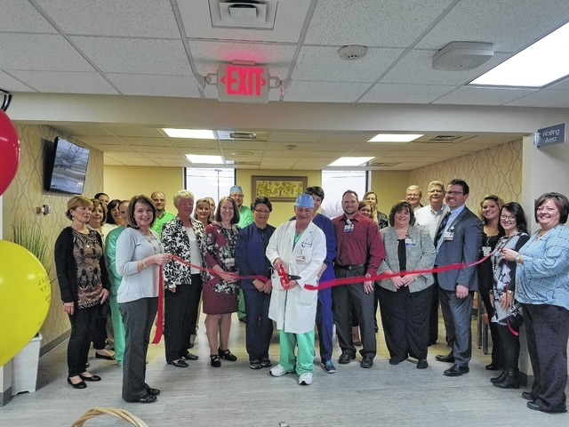 Dr. William Stevenson, general surgeon, cuts the ribbon on the new FCMH Surgery Center with the help of FCMH staff and board, Chamber Ambassadors, County Commissioners and guests.