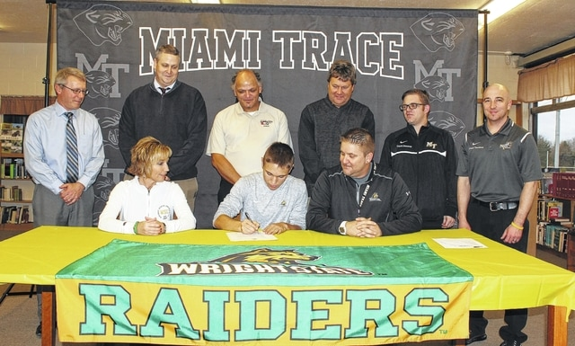 Blake Pittser, a senior at Miami Trace High School, signs a letter of intent to attend Wright State University on a full scholarship where he will continue his soccer career and study Biomedical Engineering. He is joined by his parents, Kim and Rob and (standing, l-r); Rob Enochs, Miami Trace Principal; Aaron Hammond, the school's athletic director; Scooby Daniels, director of Ohio Galaxies; Brian Kohen, NWC Alliance coach and his high school coaches, Sean Sweeney and head coach Josh Thoroman.