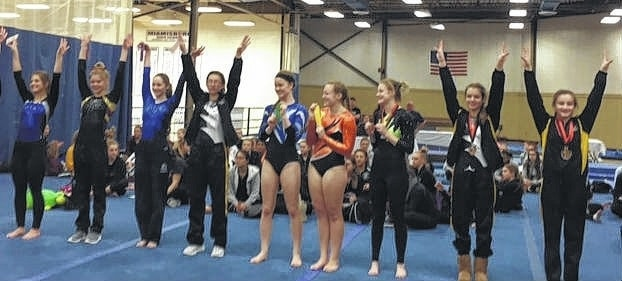 Devan Thomas (far right) stands in first place in all-around. Abby Arledge is next to her in second place out of 50 competitors.