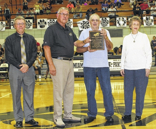 The Miami Trace Athletic Department on Tuesday, Feb. 7, presented George Hellenthal with a lifetime achievement award for his over 40 years of service to the school. Hellenthal and his wife, Bonnie, married for 62 years, were joined on the court by Charlie Andrews, former athletic director and currently a member of the Miami Trace school board and the school's principal, Rob Enochs, for the halftime ceremony. A statement read in part: Forty-two years ago, George began providing coverage of Miami Trace athletic events as a member of the Sheriff's auxiliary. Over that period of time, George was witness to and experienced many of the successes of our athletic programs. George was thorough in his work and worked to ensure the safety of both participants and spectators. George also served for six years as the coordinator of the auxiliary and for over 20 years was a member of the rapid response team. George and Bonnie have three sons, Kenny, Kevin and Kris. Without Bonnie's support, George's dedication to Miami Trace would not have been possible.