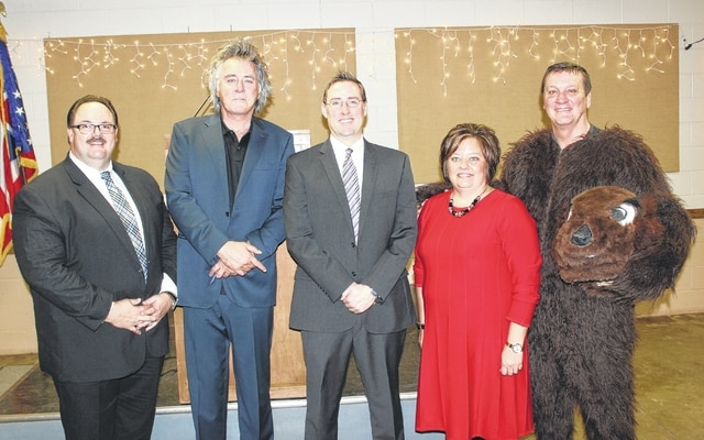 "Hillsboro Mayor Drew Hastings (second from left) was the keynote speaker at Thursday's Fayette County Chamber of Commerce Groundhog Breakfast. Chad Gibson (middle) was also a speaker at the fifth-annual event. Nick Epifano (far left), owner/operator of McDonald's of Fayette County, served as the corporate sponsor for the event. Whitney Gentry, president of the Fayette County Chamber of Commerce provided the opening and closing comments, and Dan Roberts (far right) was the ""celebrity groundhog."""