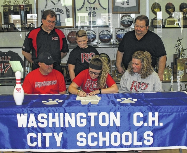 Kalee Crowe, middle, front, is flanked by her parents, Jason and Teresa Crowe as she signs a letter of intent to attend Rio Grande University where she will continue her education and be a member of the newly-formed women's bowling team. Standing (l-r); are Rio Grande head coach Bret Little, Crowe's brother, Ryan and high school coach Ron Amore, Jr.