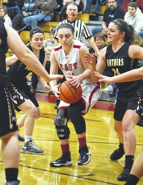 Miami Trace sophomore Becca Ratliff, left and junior Morgan Miller, double-team an East Clinton player during an SCOL game at East Clinton High School Saturday, Feb. 4, 2017.