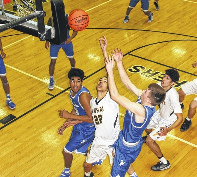 The Washington Blue Lions visited Miami Trace High School for a rivalry match in the South Central Ohio League Tuesday night. Looking to get the rebound are Miami Trace senior Keondrick Bryant (22) and Washington senior Jarett Patton, at right. Also pictured are Washington sophomore Richard Burns, left, next to Bryant, and at right is Panther senior DeAndre Pettiford.