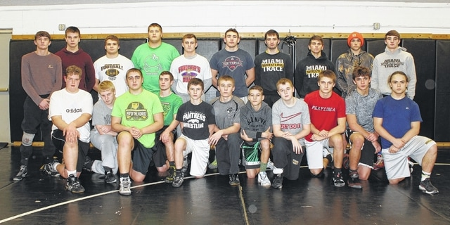 The Miami Trace wrestling team is pictured in their workout room prior to practice Thursday afternoon. The Panthers will make their debut at the State dual team tournament Sunday at 11 a.m. at St. John Arena on the campus of The Ohio State University, taking on the team from St. Paris Graham High School. (front, l-r); Grant DeBruin, David Sheets, Kayleb Terhune, Bladeth Leaman, Storm Duffy, Dylan Arnold, J.J. Puckett, Zach Tinkler, James Munro, Jotham Lewis, Aaron Morris; (back, l-r); Wes Gandee, Jacob Tinkler, Dalton Bartley, Colin Wolffe, Jack Anders, Jared Fenner, Dereck Moore, Dylan Murphy, Chris Powell and Coby Hughes.