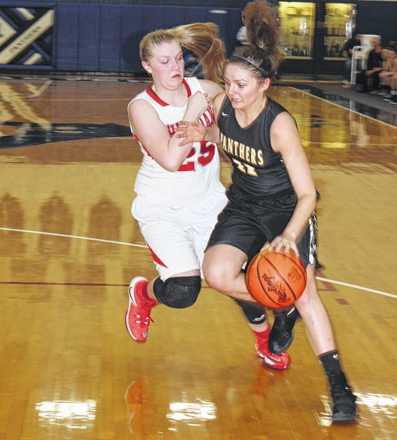 Miami Trace junior Morgan Miller drives around Sheridan sophomore Mikayla Rhodes during a Division II District semifinal game Thursday, Feb. 23, 2017 at Southeastern High School near Chillicothe.