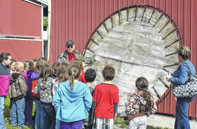 Greenfield Historical Society volunteer, Paul Wisecup, explains the history and use of the Browder lifesaving net to second graders during their annual spring visit to the society's museums.