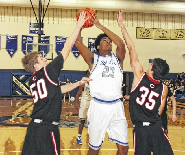 Washington sophomore Richard Burns Jr. puts up a shot while guarded by Circleville sophomore Jay Styers (50) and junior Seth Risner (35) during a Division II Sectional semifinal game at Southeastern High School Tuesday, Feb 21, 2017.