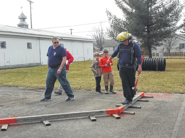 The Washington Fire Department could be seen administering tests for three volunteer firefighters Saturday afternoon to ensure proper technique and training. A small crowd of firefighters and family gathered to watch.