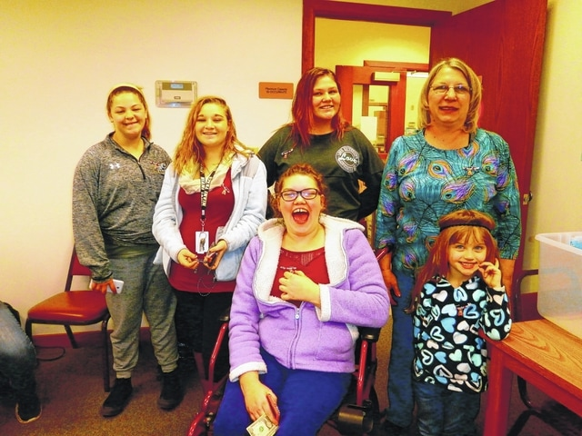 These happy folks recently created a beautiful teddy bear pin at Jeffersonville Branch Library. They are Layia Card, Tonya Reigelsperger, Riley Cook, Samantha Cox, Wendy Decker and Gabriella Webb.