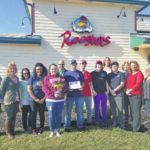 Roosters celebrates one year of business