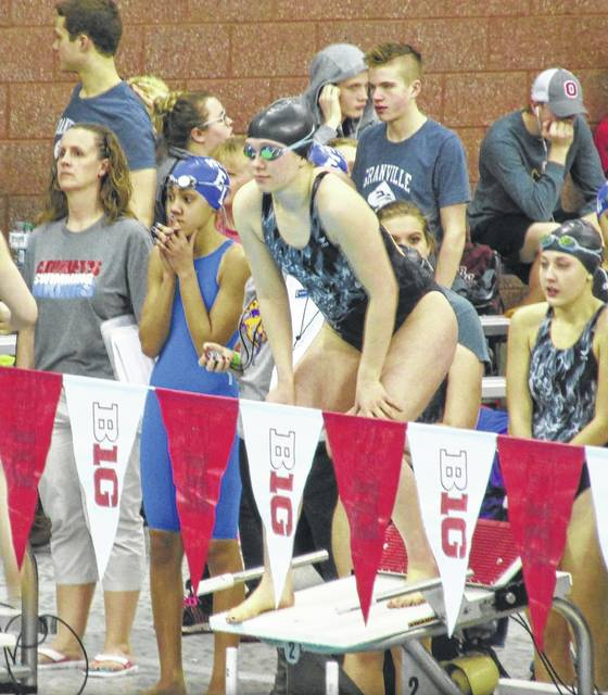 Clare Sollars is ready to swim the final leg of the 400 relay with Lauren Truex looking on in the back.