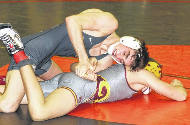 Miami Trace junior Coby Hughes wrestles Logan Iams of Ross in the championship quarterfinals of the Wilmington District tournament Friday, March 3, 2017. Hughes went 3-1, placing second at 132 pounds for a return trip to the State tournament beginning Thursday in Columbus.