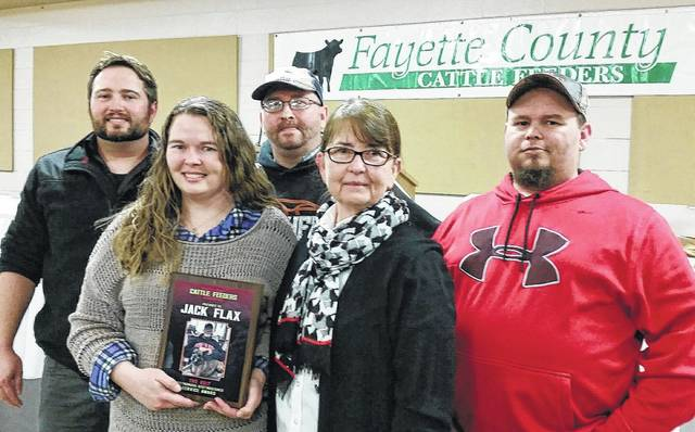 The annual Distinguished Cattlemen's Award was presented to the family of Mr. Jack Flax. The Flax family from left to right, Dustin Flax (son), Jodi Flax (daughter), Jason Flax (son), Gaye Thompson (sister), and Josh Flax (son).