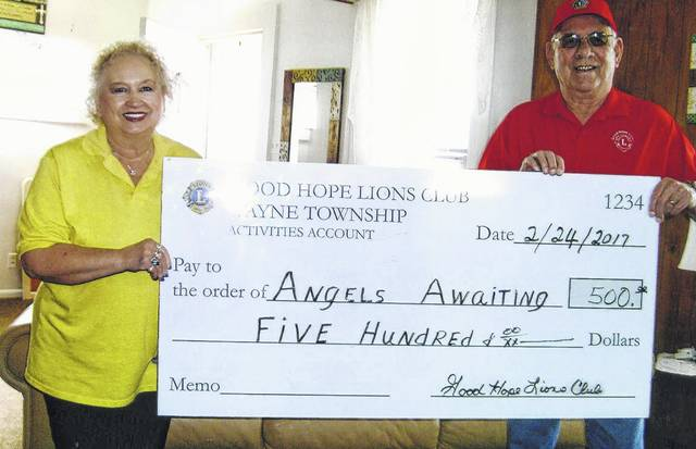 The Good Hope Lions made a donation to the Angel House recently. The Lions Club holds pancake suppers and runs a candy store each year to make money that they generously donate to local charities. Pictured is Ron Clay (a representative from the Good Hope Lions Club) and Joann Leach (president of Angel House) accepting the check.