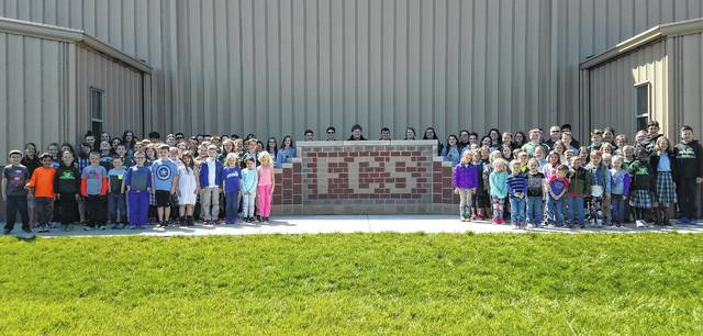 "After a recent successful Fayette Christian School auction where they raised $24,000, the students gathered to thank the community for their support of the fundraiser. Pictured are students from all grades who gave a big ""Thank you,"" while taking the photo."