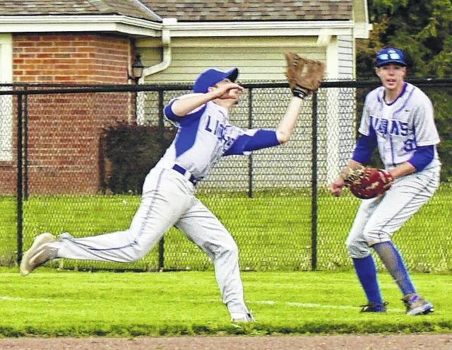 Nick Barrett makes the play for the Blue Lions as Griffin Shaw looks on during an SCOL game against the Hillsboro Indians Monday, April 24, 2017.