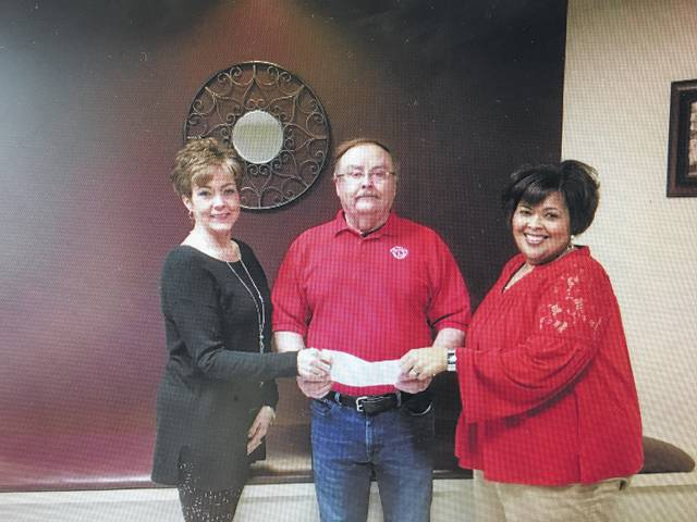 The Meals on Wheels program at the Fayette County Commission on Aging received a check for $1,000 from the Good Hope Lions Club.