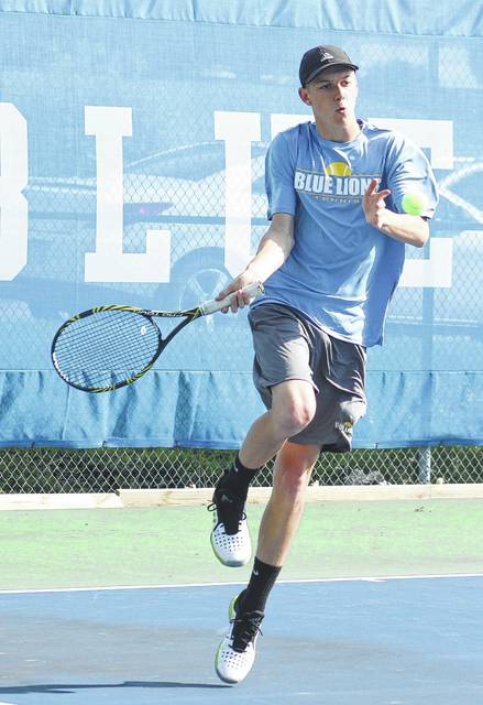 Jordan Behm returns a shot at second singles for Washington during a match against Spencer Brown of Hillsboro Monday, April 24, 2017 at Gardner Park.