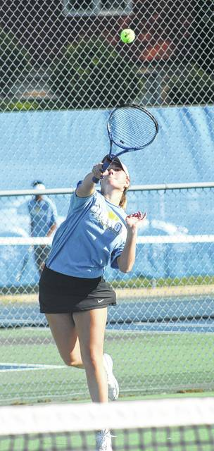 Madalyn Wayne serves for Washington during a doubles match against Wilmington Wednesday, April 26, 2017 at Gardner Park.