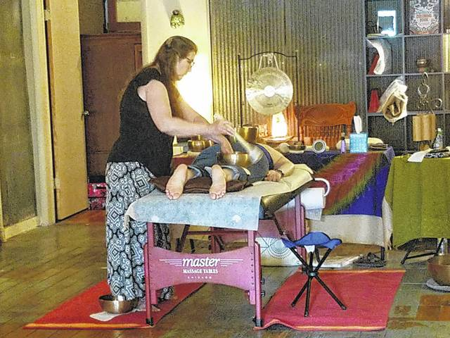 Deborah Wolfe, certified sound therapist, had a full schedule Saturday during the second-annual Chocolate Walk for her vibrational sound massage while patrons ate chocolate and watched her work. For more information contact Wolfe at (937) 218-6433 or email deb55wolfe@gmail.com