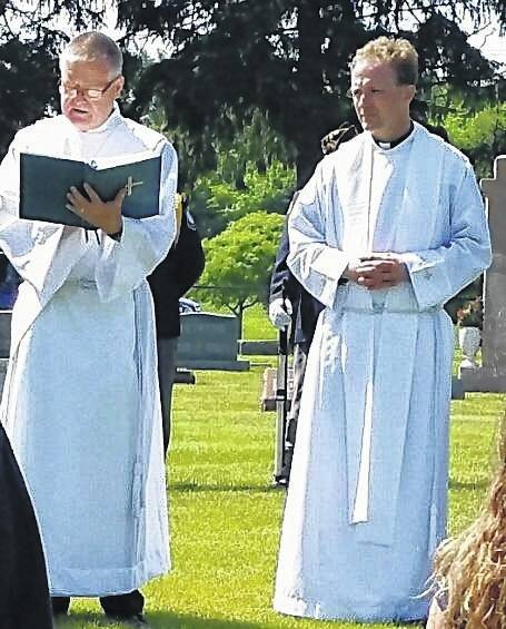 Father Mike Hartge and Deacon Reed Hauser spoke of the need to remember those who have given all for the freedoms we enjoy today.